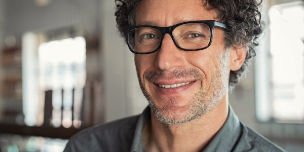 Smiling man wearing eyeglasses